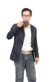 Portrait of young asian man drinking hot drink in coffee mug cup Stock Photography