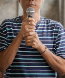 Portrait of young asian man and microphone in hand Royalty Free Stock Image
