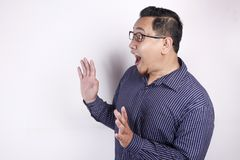 Man Shocked to See Something on his Side, Excited Gesture with Copy Space royalty free stock image