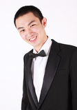 Portrait of young asian man wearing tuxedo. Stock Images