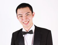 Portrait of young asian man wearing tuxedo. Royalty Free Stock Images