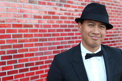 Portrait of young asian man wearing tuxedo and a fancy hat Royalty Free Stock Image