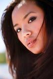 Portrait of a young asian model. Closeup portrait of a young asian model outdoors royalty free stock photo
