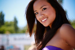 Portrait of a young asian model. Closeup portrait of a young asian model in swimwear on the beach royalty free stock photography