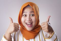 Muslim Lady Shows Thumbs Up Gesture stock photography
