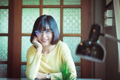 Portrait young Asian pretty student woman smiling and looking camera Royalty Free Stock Image