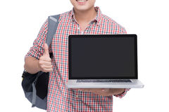 Portrait of young asian student holding and showing screen lapto Royalty Free Stock Photos