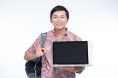 Portrait of young asian student holding and showing screen lapto Stock Image