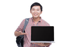 Portrait of young asian student holding and showing screen lapto Stock Photography