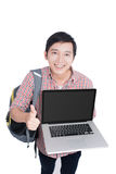 Portrait of young asian student holding and showing screen laptop royalty free stock images