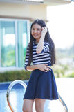 Portrait of young asian teen smiling face happiness emotion at h Royalty Free Stock Image