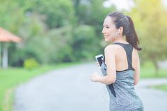 Portrait of a young asian woman doing outdoor exercise in park, stock photo