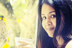 Portrait young asian woman drinking hot green tea latte in coffe. E shop Royalty Free Stock Image