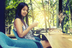 Portrait young asian woman drinking hot green tea latte in coffe. E shop Royalty Free Stock Photography