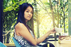Portrait young asian woman drinking hot green tea latte in coffe. E shop Royalty Free Stock Photo