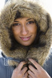 Portrait of young Asian woman in hooded fur coat Stock Photos