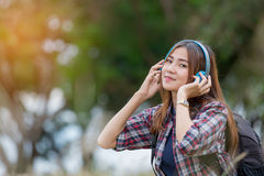 Portrait of young  asian woman listening music Stock Photography