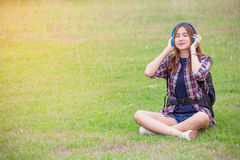 Portrait of young  asian woman listening music Stock Images