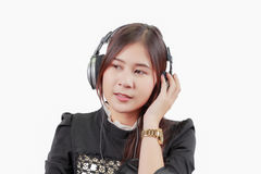 Portrait of young Asian woman listens and enjoys the music in he Stock Photo