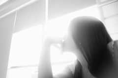 Portrait of young asian woman looked at the light,hope concept,find the future concept,high key picture style. Black and white color picture,soft focus Royalty Free Stock Photography