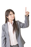 Portrait of a young asian woman pointing and selecting Stock Image
