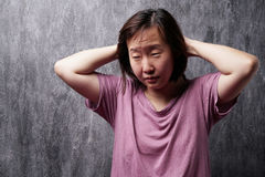 Portrait of young asian woman with sleepy face. stock photography