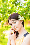 Portrait of young asian woman in spring blossom trees royalty free stock image