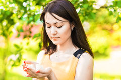 Portrait of young asian woman in spring blossom trees stock photo