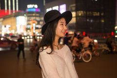 Portrait of a young beautiful women on city streets at night Stock Photos