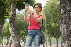 Portrait of young asian woman using smart phone Royalty Free Stock Images