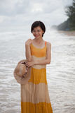 Portrait of young asian woman wearing long dress with smiling fa Royalty Free Stock Photo