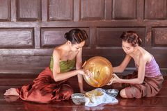 Portrait young asians women dressed in ancient Thailand are helping to make the dessert thai of Thai culture. Thailand Royalty Free Stock Images