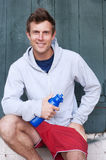 Portrait of a young athlete holding water bottle Stock Photography