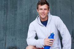 Portrait of a young athlete holding water bottle Royalty Free Stock Photos
