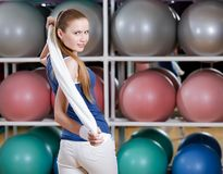 Portrait of a young athletic girl with towel Stock Photos