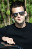 Portrait of a young athletic man with sunglasses Stock Photos