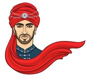 Portrait of the young attractive Arab man in a turban. Royalty Free Stock Photography