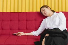 Business woman portrait. Portrait of young attractive Asian businesswoman, exhausted, fatigue from overworked on long and busy working days, doze off, fell stock images