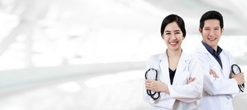 Portrait of young attractive asian doctor team or physician group crossed arm holding stethoscope medical equipment stock images