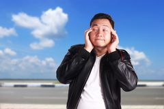 Young Asian Man Having Headache Royalty Free Stock Photo
