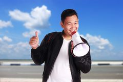 Young Man Shouting with Megaphone, Promotion Concept Stock Photography