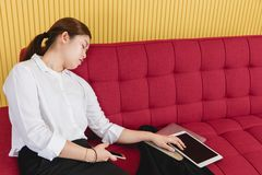 Business woman working. Portrait of young attractive Asian startup businesswoman, exhausted, fatigue from overworked on busy working days, doze off on big red royalty free stock image