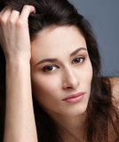 Portrait of a young and attractive brunette woman Royalty Free Stock Images