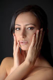 Portrait of young attractive brunnete woman holding her face in her hands with sugar on her lips Royalty Free Stock Photo