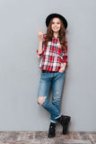 Portrait of a young attractive casual girl in plaid shirt Stock Photo