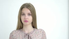 Portrait of young attractive Caucasian girl on white background stock footage