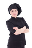 Portrait of young attractive cook woman in black uniform isolate Stock Images