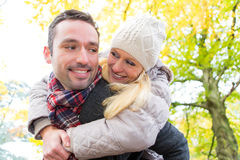 Portrait of a young attractive couple in a park Stock Images