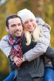 Portrait of a young attractive couple in a park Royalty Free Stock Photos
