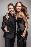 Portrait of young attractive couple posing at studio dressed in black fashionable clothes. Photo Royalty Free Stock Photos
